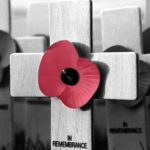 Poppy on a wooden cross
